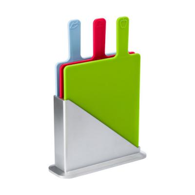 Image of Three piece plastic cutting board set in a silver coloured holder